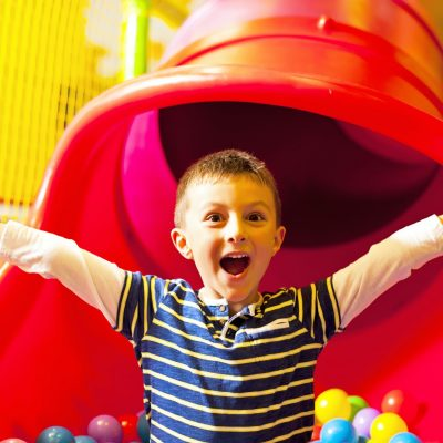 Little boy in the ball pool